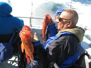 Vietnam Veteran Juan Trevino holds up three fish he caught during the Rock Cod Derby.