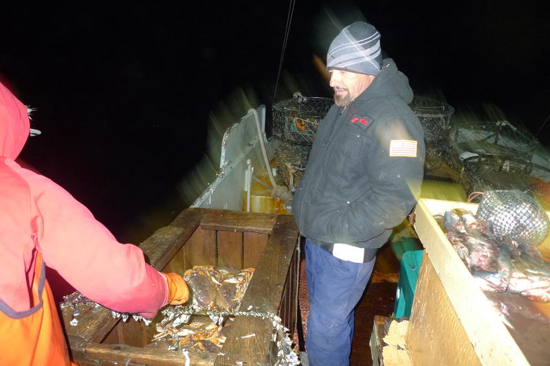 3:00am: Leo Morelli inspects the Dungeness crabs hauled aboard the Capo in the middle of the night.