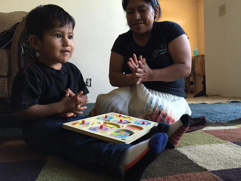 Samuel's mother, Floriana Lopez, claps when he gets an answer right during his MCOE therapy session.