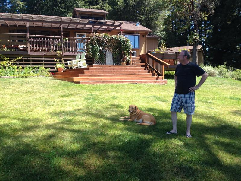 Save Our Skies Santa Cruz Co-Chair Patrick Meyer stands in front of his house in the Santa Cruz Mountains with his dog, Miss Tara.