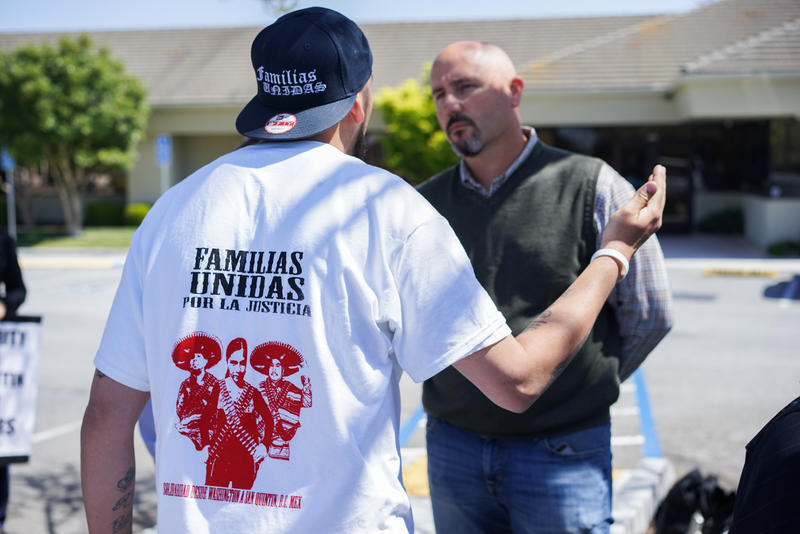 Lead protest organizer Ramon Torres of Familias Unidas por la Justica tells a Driscoll's representative that he wants the Watsonville company to help his union get a contract.
