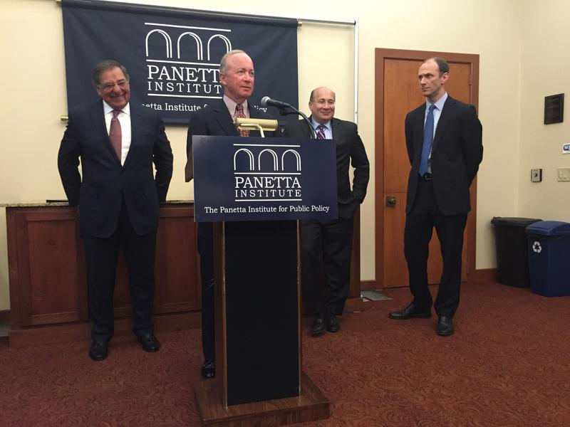 From left to right: Secretary Leon Panetta, Mitch Daniels, Ron Isana and Austan Goolsbee speaking at a press conference before the forum.