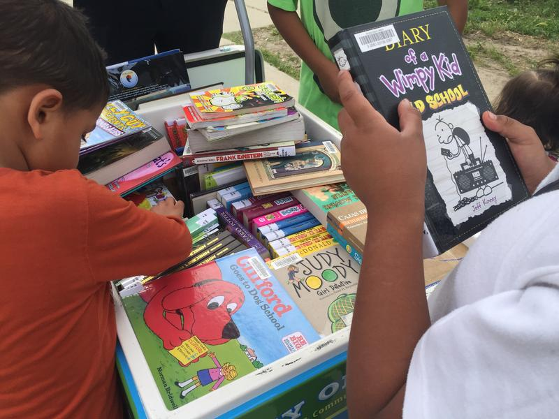 Kids browse the books in the Salinas Public Library's Paletero cart.