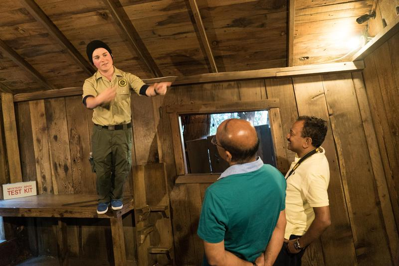 Tour guide Rob Oberto demonstrates the strange qualities of the Santa Cruz Mystery Spot.