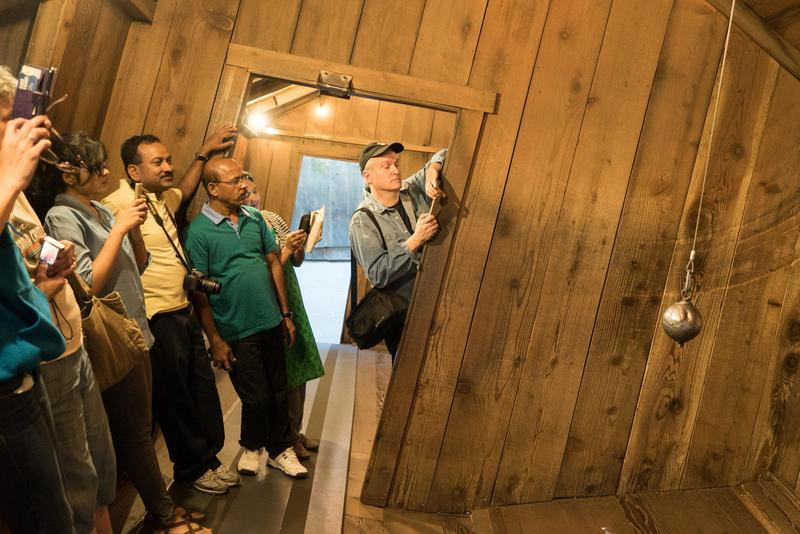 Doug Kirby of Roadside America takes a photograph at the Santa Cruz Mystery Spot.