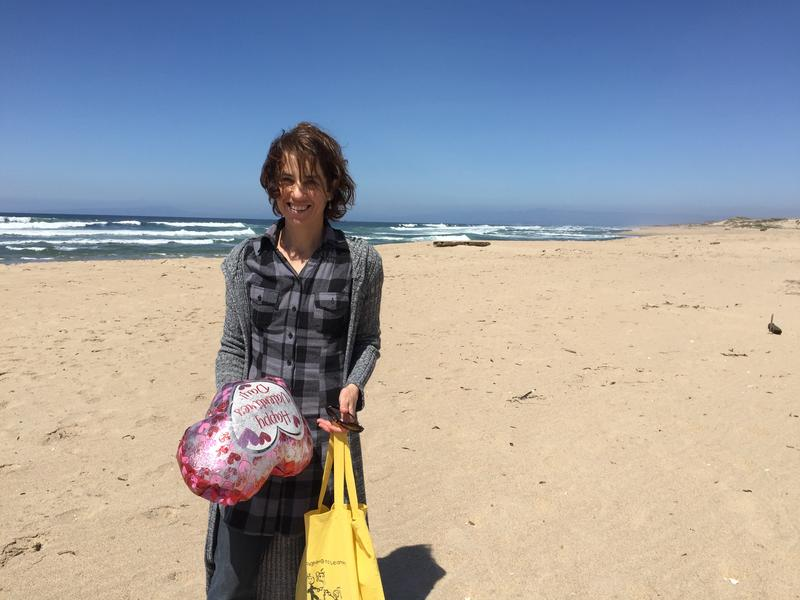 Ximena Waissbluth of the Surfrider Foundation Monterey Chapter picks up trash on a walk to the CEMEX Sand Mine.
