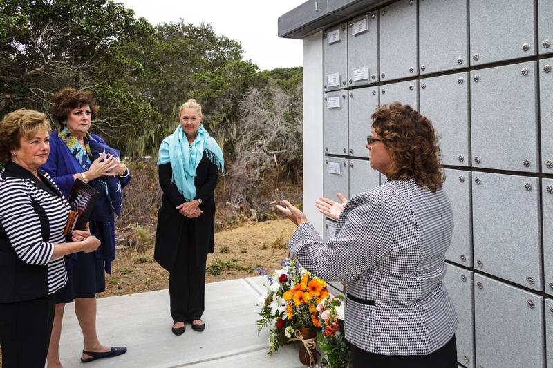 Family and friends of Airman First Class Alex Klein and his wife Jacquelyn gather around their columbarium.