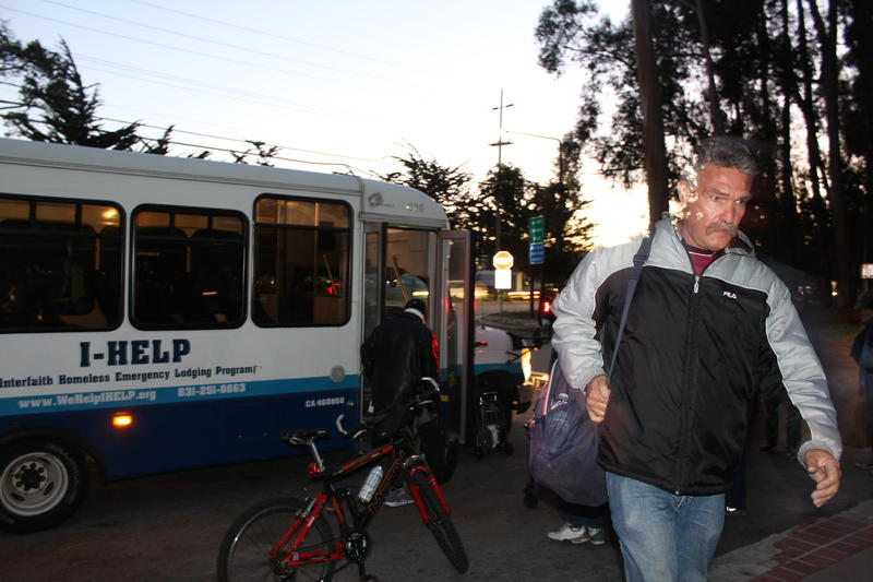 A man gets ready to board the I-HELP bus. I-HELP, the Interfaith Homeless Emergency Lodging Program, shelters up to 25 homeless men and women every night.