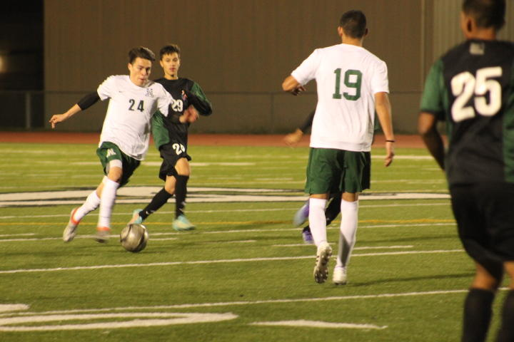 Alisal High School's Varsity Soccer team (white) playing a game earlier this month.