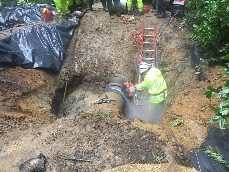 Crews work to repair the Newell Creek Pipeline, which sprung a leak Monday after the weekend storm.