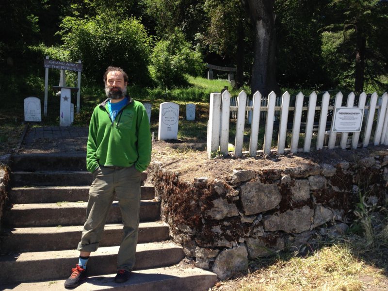 Sibley Simon stands in front of Evergreen Cemetery in Santa Cruz.