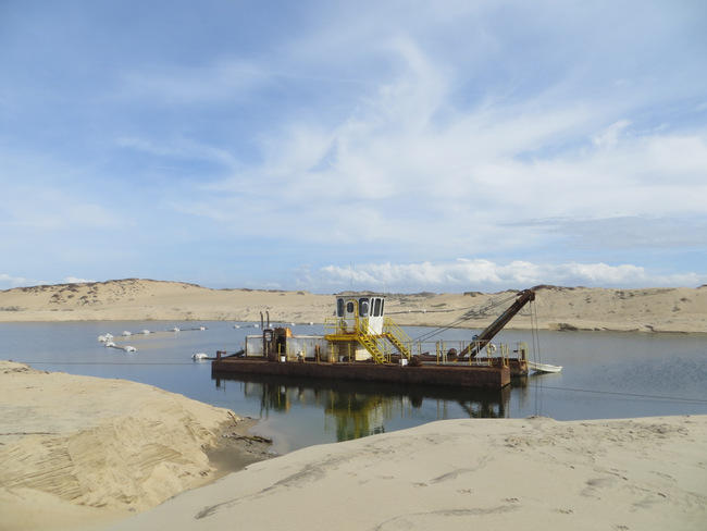 CEMEX uses a dredge boat on the beach in Marina to extract sand.