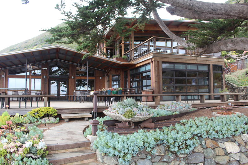 The lodge, home to the kitchen and dining room, is surrounded by succulents.