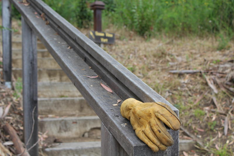 A work glove hangs on a railing. It's a sign of all the prep work employees have done to get ready for the reopen.