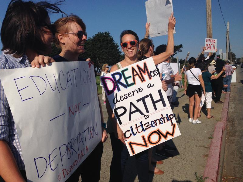 Demonstrators held up colorful signs to show their support for DACA.