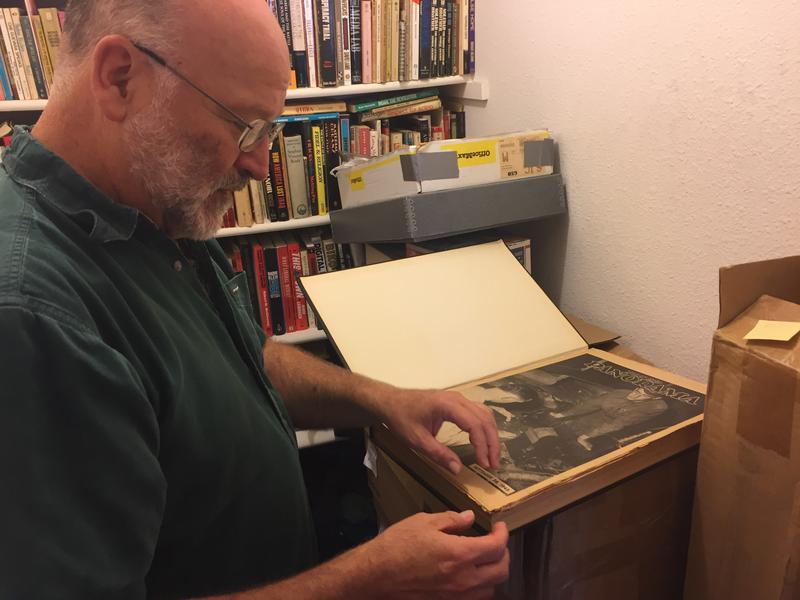 Steve Levinson looks through bound copies of the old Fort Ord newspaper, The Panarama.