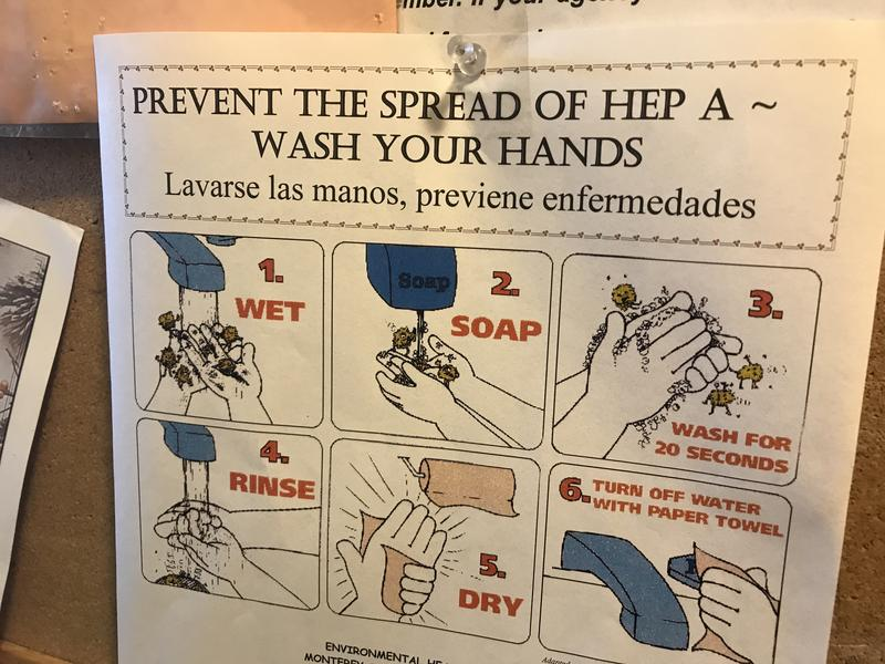 A sign about hepatitis A hangs on a corkboard at Dorothy's Place in Salinas, a homeless service provider.