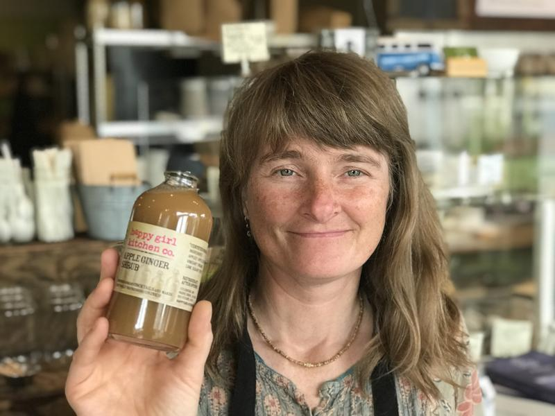 Happy Girl Kitchen co-owner Jordan Champagne holds up one of her products. She's hoping her jams or marmalades appear in Big Little Lies.