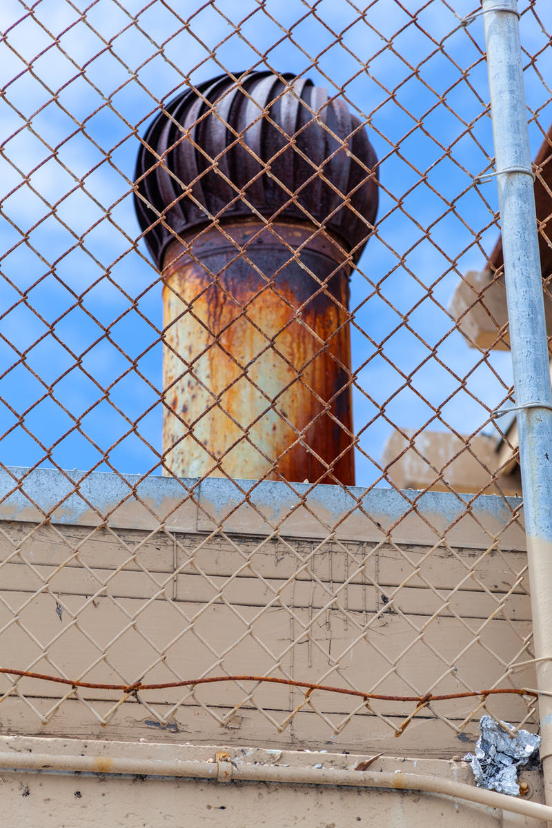A rusting vent on top of Seaside High School.