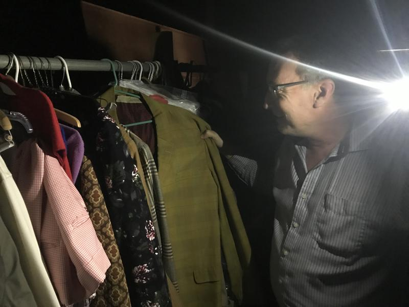 Pacific Repertory Theatre has stored their costumes in an old warehouse on former Ft. Ord for decades. There's no electricity, so Pac Rep Founder Stephen Moorer uses his phone's flashlight. Moorer says many local theaters deal with subpar storage areas.