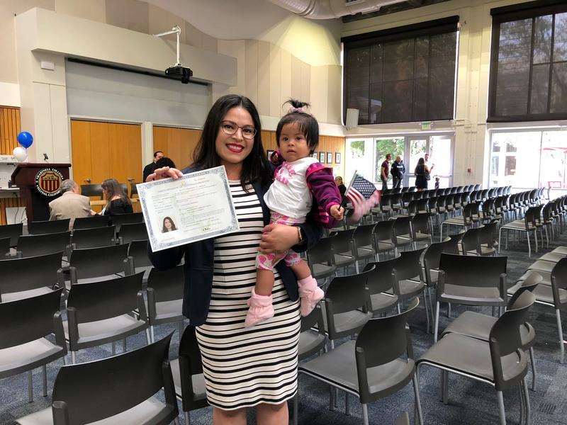 New U.S. citizen Maria Veronica Serratos Valdivia holds her niece.