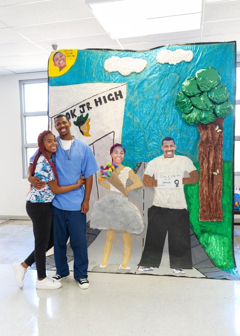 One of the biggest activities is making murals. The theme is 'a perfect day with dad.' The Ellis family illustrated Taniya's 8th grade graduation.