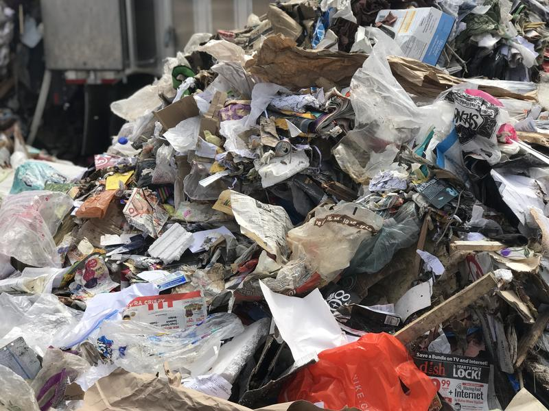 Plastic bags and other plastic film can easily be spotted in the piles of waste at the landfill.