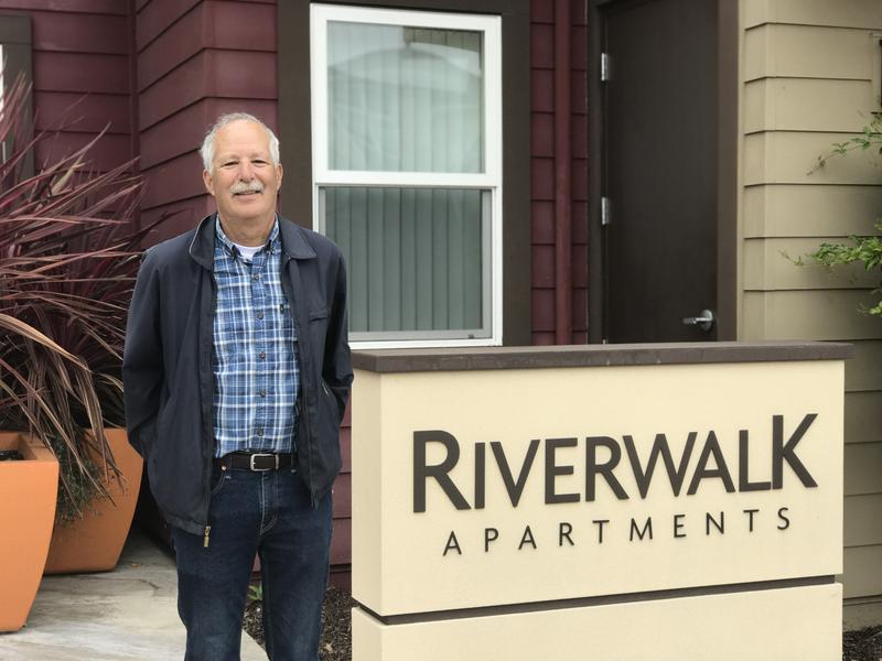 Don Lane, Co-Chair of the Yes on H Campaign, stands in front of Riverwalk Apartments. Lane was Santa Cruz Mayor when the affordable apartment complex opened near downtown SC in 2015. He says seeing it come to fruition was a highlight of his time as mayor.