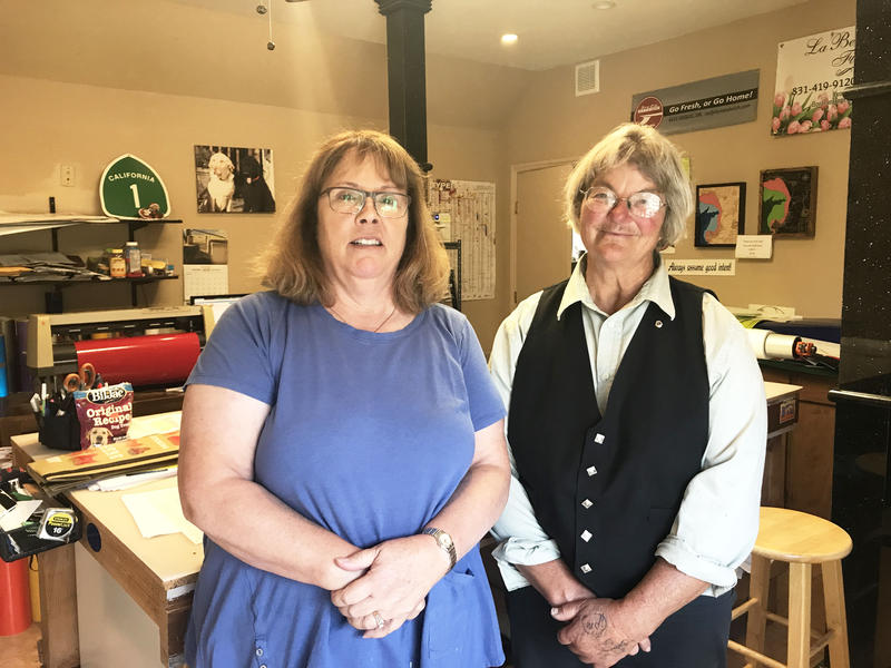 No on H Campaign members Kris Kirby and Becky Steinbruner stand together in Kirby's Aptos sign shop. The homeowners say paying another property tax to fund Measure H is overwhelming.