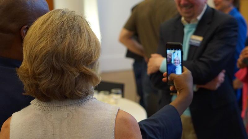 Glynn Washington and Salon Member taking a photo at KAZU Salon Event