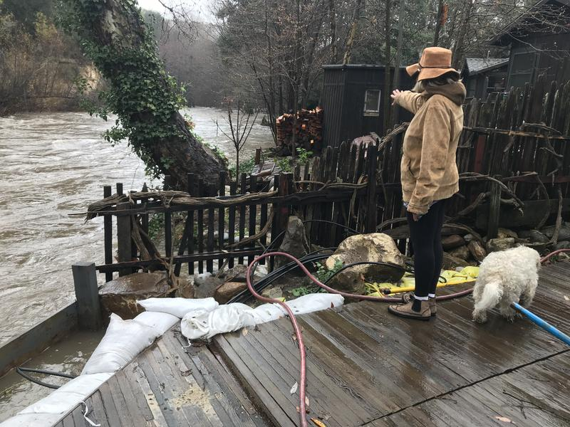 Joshlyn Scheid-Baggett and husband Brian Baggett lined their deck with about 200 sandbags.