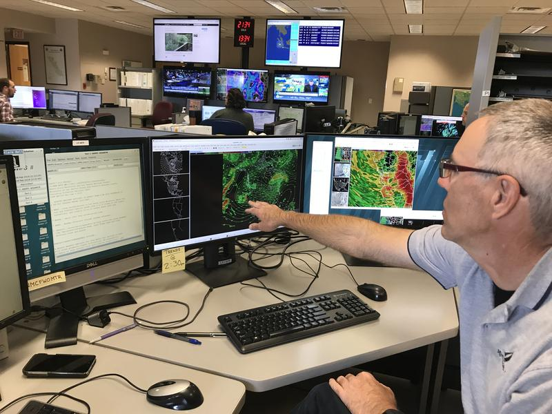 National Weather Service Forecaster Duane Dykema points to a weather model. Rain is expected through Tuesday morning along with snow in high elevations.