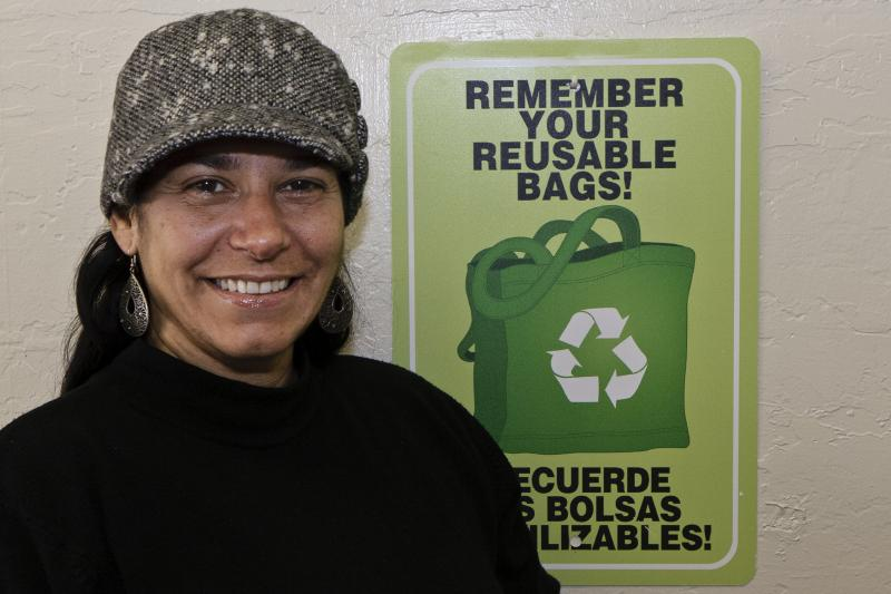 Deli-Licious owner Carla Oliveira participants in the voluntary restaurant ban of plastic bags at her Live Oak restaurant..