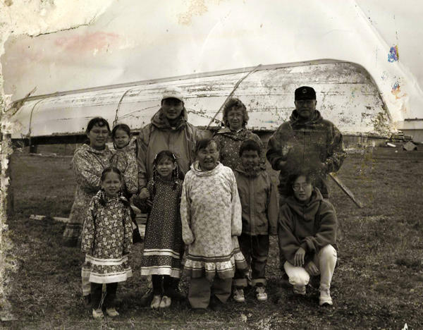 Leonard Apangalook (right rear) and his family on a Saint Lawrence Island beach.
