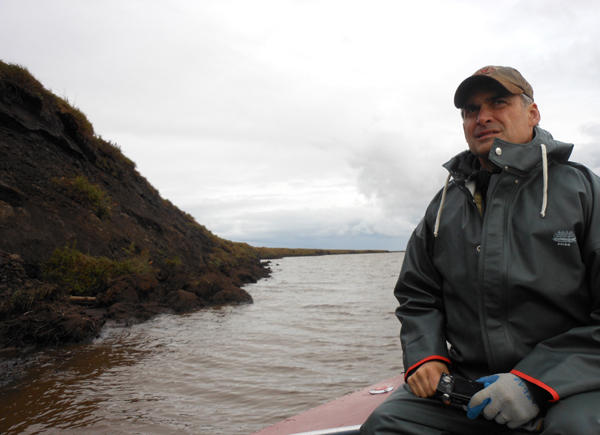 Michael Brubaker, chief investigator for the Alaska Native Health Consortium, heads along the Selawik River to check out erosion caused by melting permafrost in Northwest Alaska.