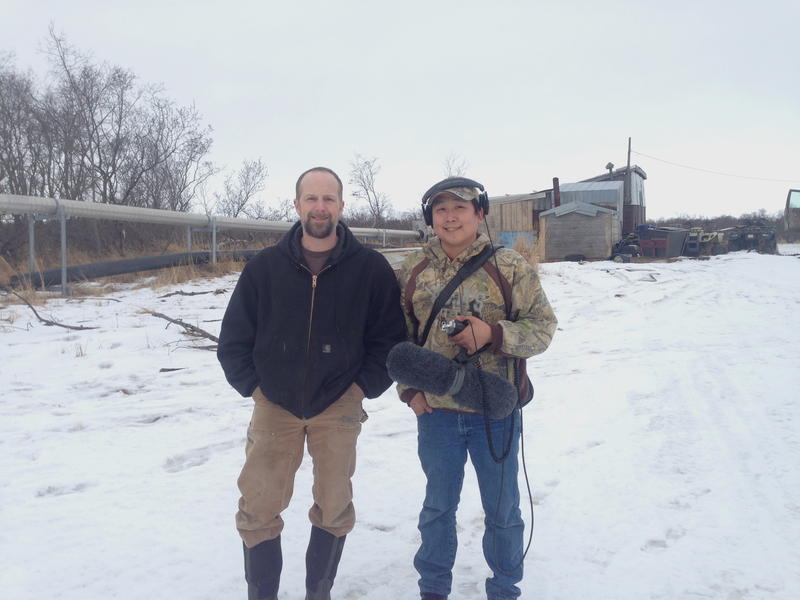 Bob Smith, Yukon-Kuswkokwim Health Corporation at left, with Charles Enoch, a reporter for KYUK FM in Bethel, in Kwethluk.