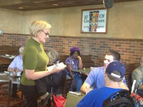 McCaskill serving food