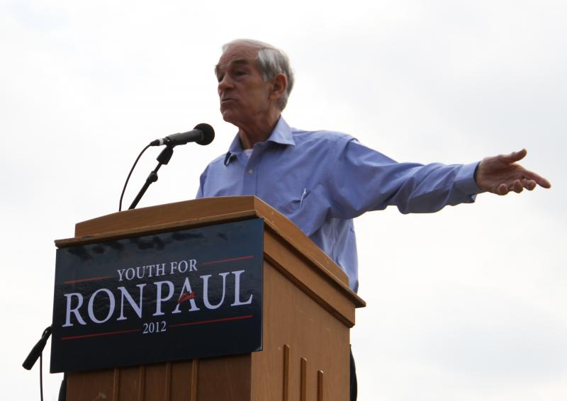 Presidential candidate Ron Paul gestures while making a speech on the south end of the David R. Francis Quadrangle on the University of Missouri campus on Thursday, March 15, 2012.
