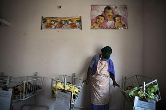 A nurse takes care of abandoned baby girls in the Life Line Trust Home in Tamil Nadu, India, on February 8, 2010. In its latest initiative to wipe out the practice of female foeticide and female infanticide, the government of Tamil Nadu.