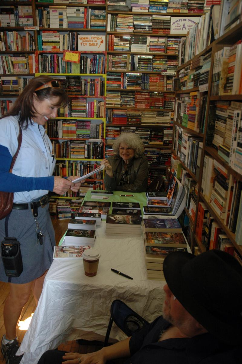Authors Judy Moresi and Mark Tiedemann chat with cruisegoers during a signing at the Book House in St. Louis, Mo.