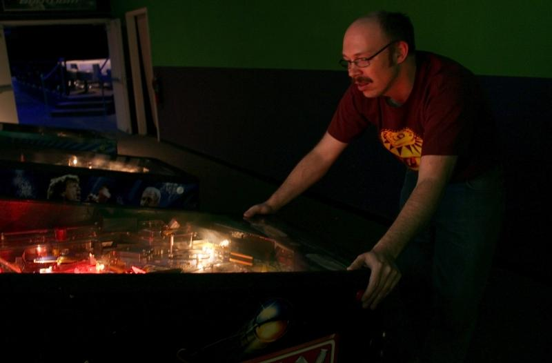 Adam McKinnie/Zed plays pinball in Columbia, Mo.