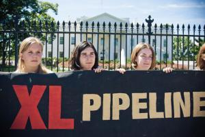 Activists protest the Keystone XL pipeline project outside the White House in August.