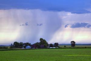 Rain batters a farm near Nevada, Iowa, in August 2010.