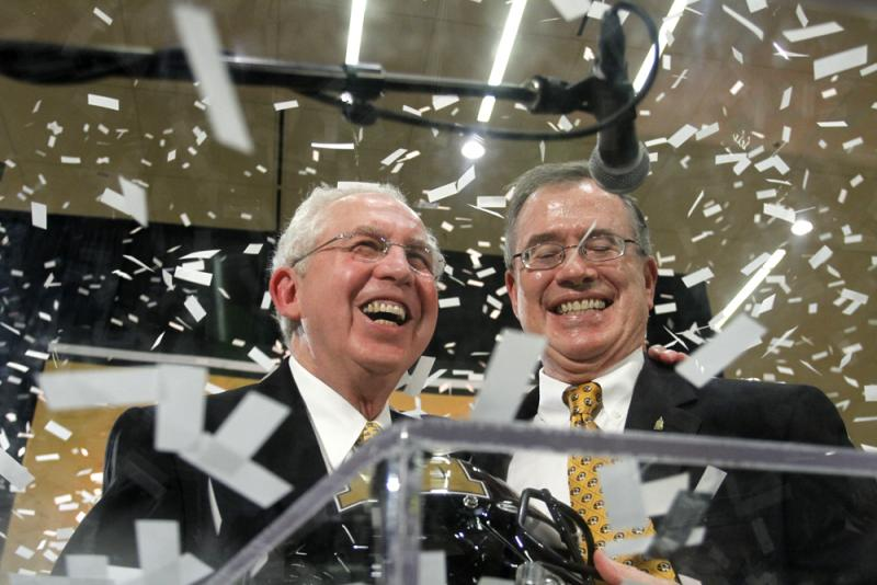 SEC Commissioner Mike Slive, left, and Missouri Chancellor Brady Deaton celebrate the announcement of Missouri's entrance into the SEC, Sunday, Nov. 6, 2011, at the Student Center at MU in Columbia, Mo.