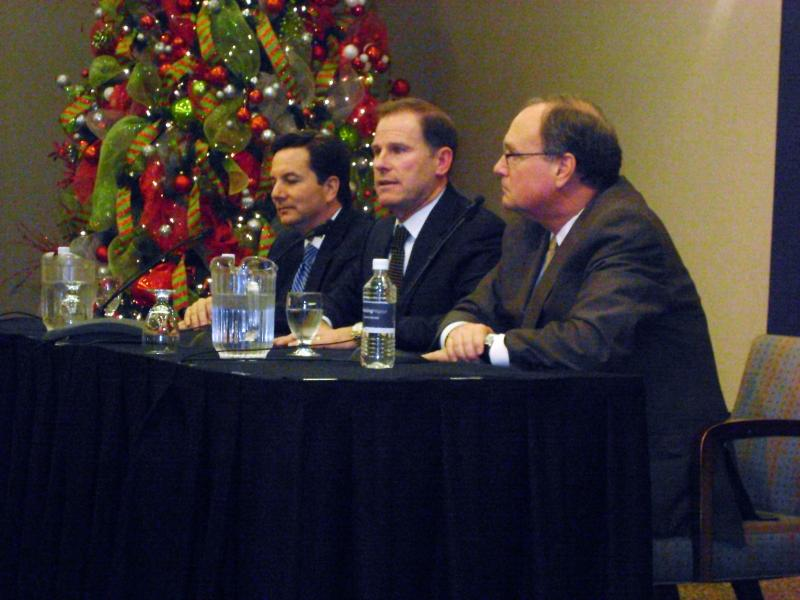 University of Missouri system Interim President Steve Owens (L), incoming president Timothy Wolfe and curator Warren Erdman (R) take questions following Wolfe's introduction as the system's next leader Tuesday morning, Dec. 13, 2011.