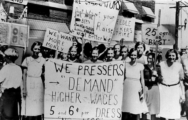 Women pressers on strike for higher wages.