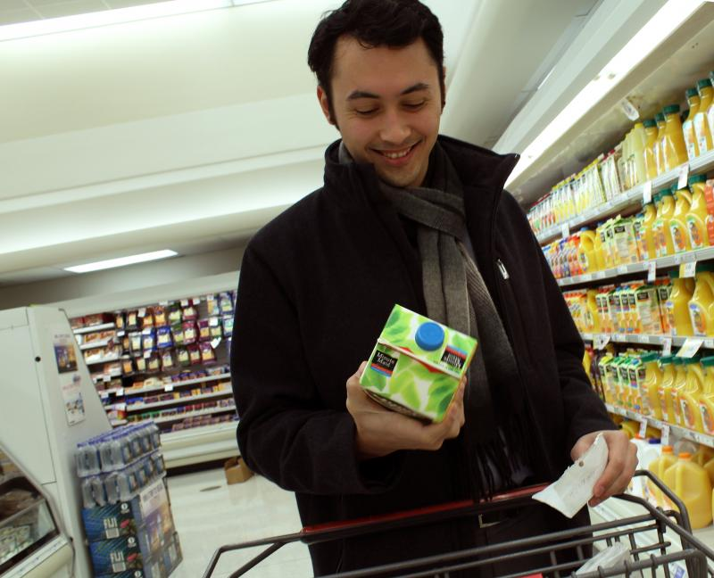 Scott Pham studies the nutrition facts on a container of 100 percent juice.