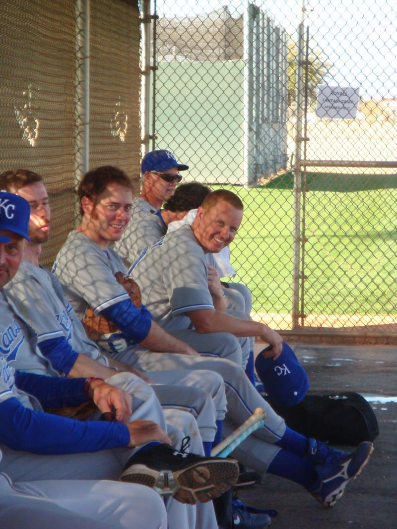 The team sits in the dugout during a game at Royal's Fantasy Camp in Surprise, Ariz.