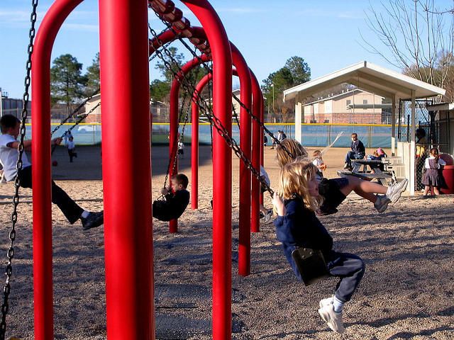 Kids play on a playground. The Buddy Pack program sends kids in 32 Missouri counties home with a backpack of nutritious food each weekend, but the program is facing the challenges of rising food and fuel costs.