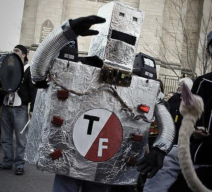 A T/F robot walks the March March parade at 2011's True/False Film Festival